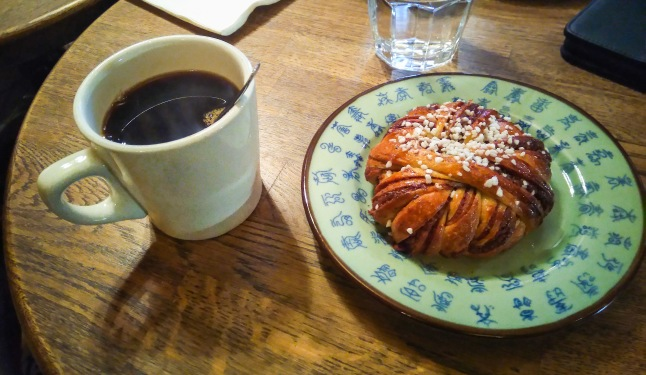 Cinnamon Bun and Coffee sweetened with honey