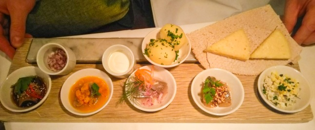 Platter of pickled Herring with Vasterbotten Cheese and condiments
