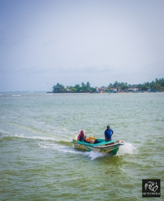 A small Fishing boat entering the lagoon